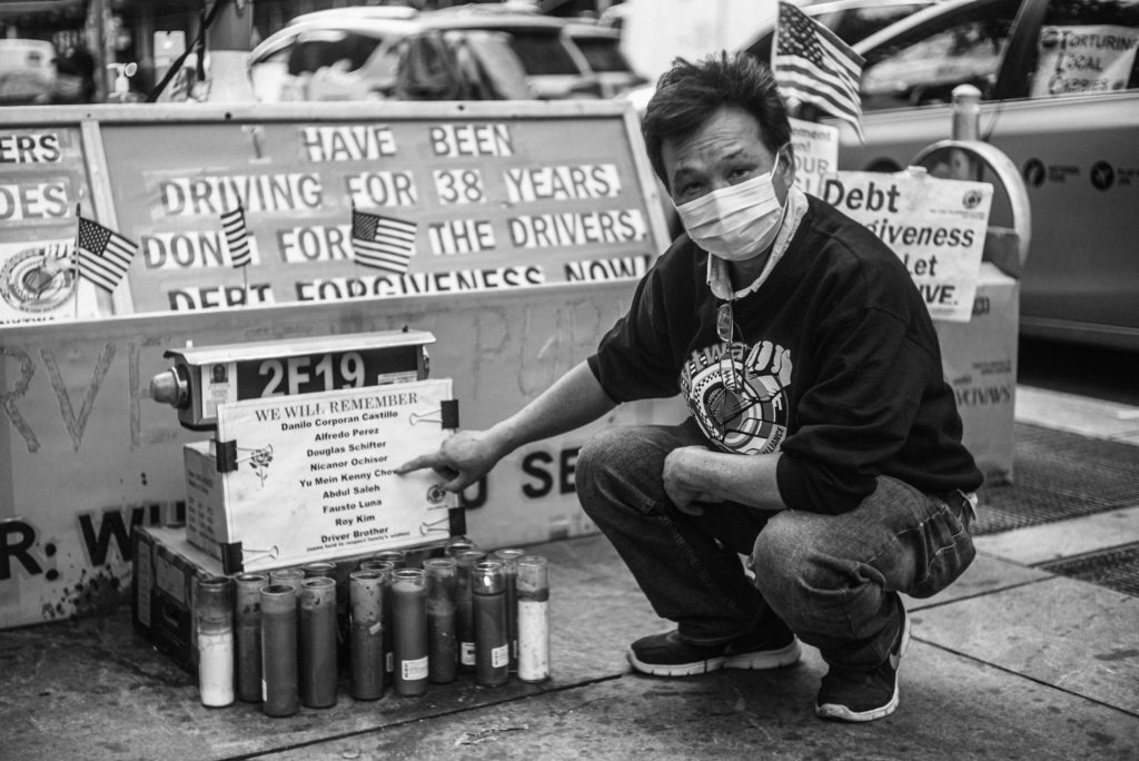 Richard Chow points to his brother's name on the list of drivers that have committed suicide.